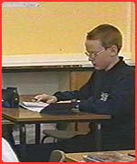 Christopher in his new classroom