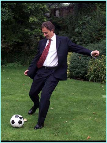 Prime Minister Tony Blair kicks a football in the back garden of 10 Downing Street as he launches a project to improve grass-roots soccer skills