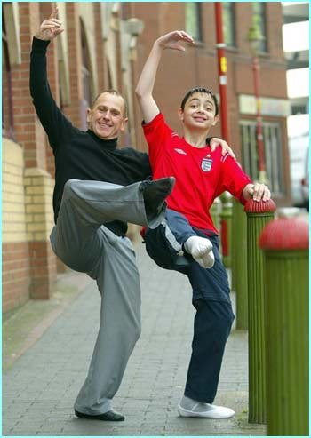 Dancer Wayne Sleep putting his 50,000th student through his paces