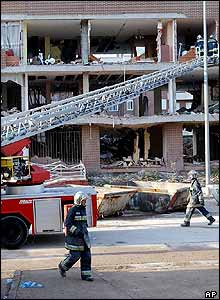 Firefighters work at the scene of the apartment block, Madrid, 4 April 2004