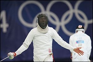 Rustem Sabirkhuzin celebrates his fencing win in the modern pentathlon