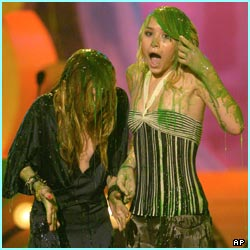 The Olsen twins get slimed, it's hard to tell which one is which, but neither of them look very happy