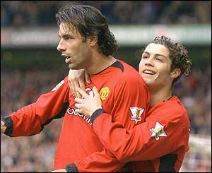 Ruud van Nistelrooy is congratulated by Cristiano Ronaldo
