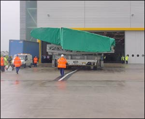 The wing is moved out of the factory