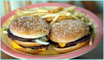 Quarter pounder with cheese and fries = 40g of fat. Fats are the most concentrated source of energy in food. Just 1 gram of fat contains 9 calories of energy; more than double the calories in a gram o