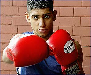 At the age of 8 Amir got into boxing after watching Muhammad Ali fight on TV