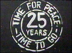 "Poster in Northern Ireland reads ""25 Years - Time for Peace - Time to Go"""