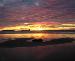 Photograph by Ioan and Jo from Penarth taken late afternoon in January from Rhosili Beach looking out to Worms Head.