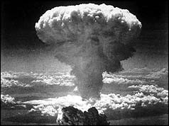 A mushroom cloud rising into the air after the atom bomb was dropped on Nagasaki