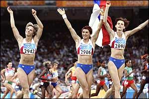 Russian silver medalist Simagina (left), gold medalist Lebedeva (centre) and bronze medalist Kotova celebrate with their country's flag