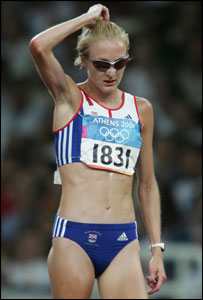 Paula Radcliffe pulls her hair