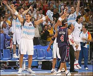 Argentina celebrate defeating the USA as USA's Allen Iverson walks off dejected