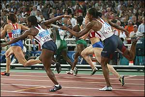 Lauryn Williams (left) and Marion Jones fumble the baton