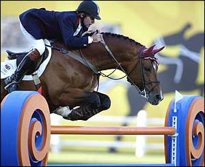 British jumping rider Nick Skelton clears a fence on his horse Arko III