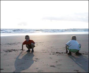 Steve Salter's children writing their names in the sand at Ogmore by Sea beach