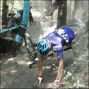Oli Beckinsale falls off his bike in the mountain biking cross country