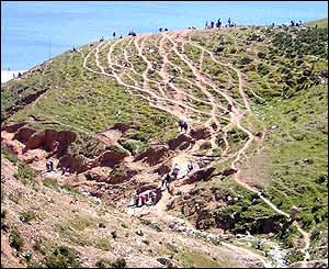 People crossing mountains near Ceuta