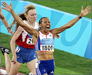 Kelly Holmes becomes the first Briton for 84 years to achieve the Olympic middle distance double