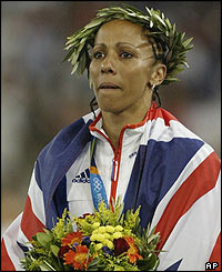 Kelly Holmes stands on the podium as double Olympic champion