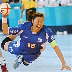Im Jeong Choi goes on the attack in the women's handball final as Korea take on Denmark