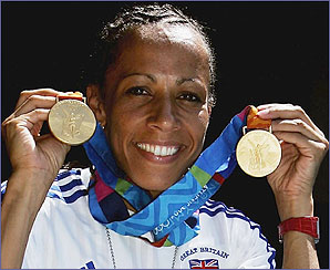 Kelly Holmes shows off her two gold medals