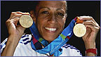Kelly Holmes shows off her two Olympic gold medals
