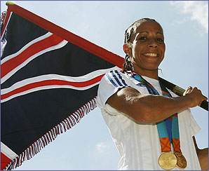Kelly is the flag carrier for GB at the closing ceremony of the Athens Olympics