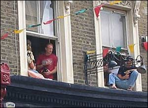 People watching from their windows
