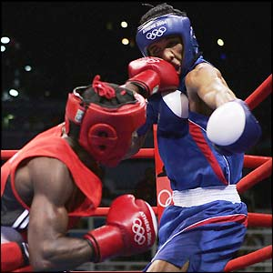 Guillermo Rigondeaux lands a shot on Thailand's Worapoj Petchkoom on his way to winning the gold