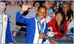 Kelly Holmes greeted by fans at Gatwick airport on Monday