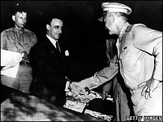 General G Castellano, representing Italy, receives a handshake from General Dwight D Eisenhower