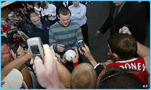 Wayne Rooney signs autographs at Manchester United