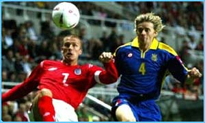 Ukraine's Anatoliy Tymoschuk and England's David Beckham battle for the ball during an international friendly