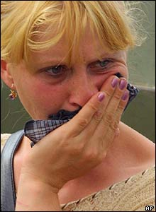 A woman waits anxiously outside the school in Beslan