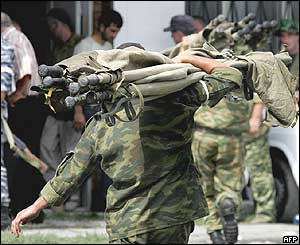 Russian soldier carries stretchers