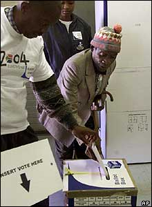 Election official helping an old man to vote