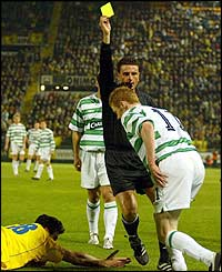 Celtic's Stephen Pearson gets a yellow card