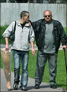 Young man carries a prosthetic leg for his father in bratislava