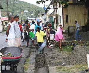 Locals begin the huge clean-up task in Castries, St Lucia