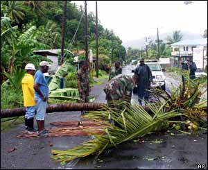 Locals take part in clean-up efforts in the village of Dennery on the coast of Castries, St Lucia