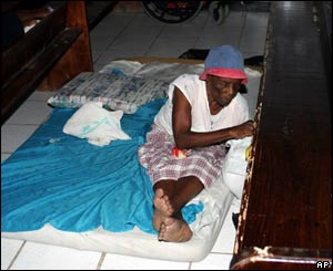 Her home damaged, a woman takes shelter from the fierce winds in a church in Castries, St Lucia