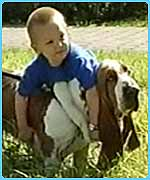 Picture of basset hound and boy