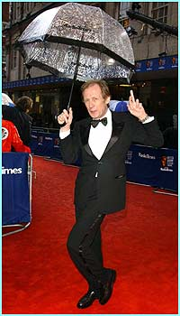 Bill Nighy strikes a pose with his brolly! He later took the Bafta for best actor