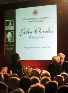 Around 1,000 people gathered at Swansea's Brangwyn Hall to pay tribute to John Charles who died in February