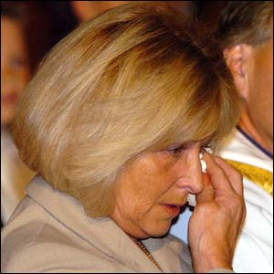 John Charles' widow Glenda listens to the tributes to her late husband
