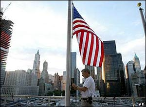 Merrill Lynch employee Michael George lowers US flag to half-mast