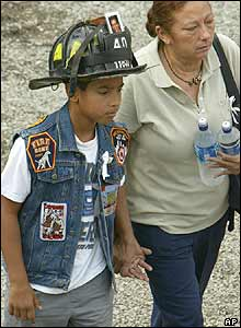 A youngster wears a firefighter's helmet at Ground Zero