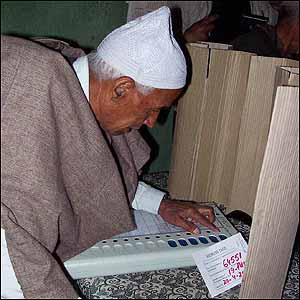 Man with voting machine