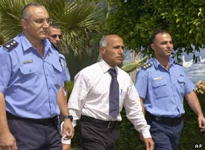 Mordechai Vanunu is escorted from prison