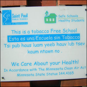 School sign written in English, Spanish and Hmong